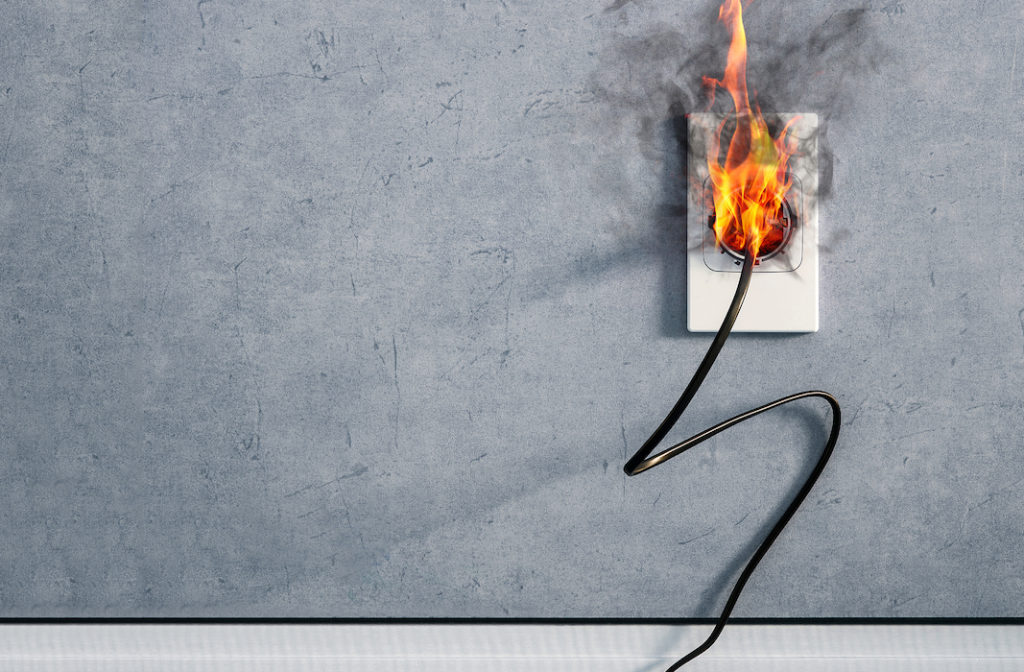 Burning power outlet with fire