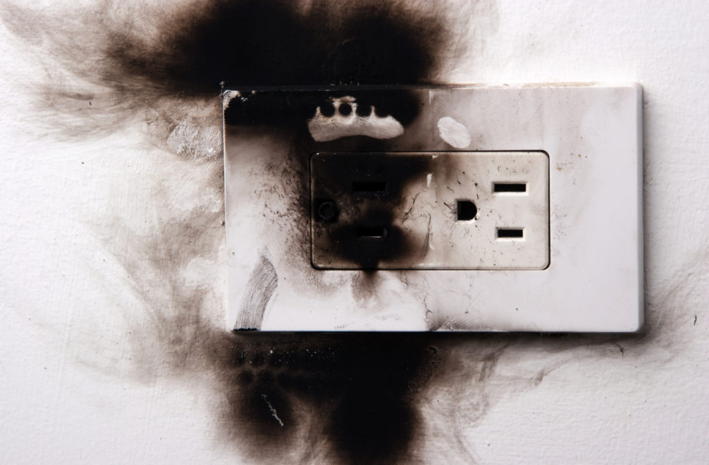 Damaged power outlet caused due to short circuit.
