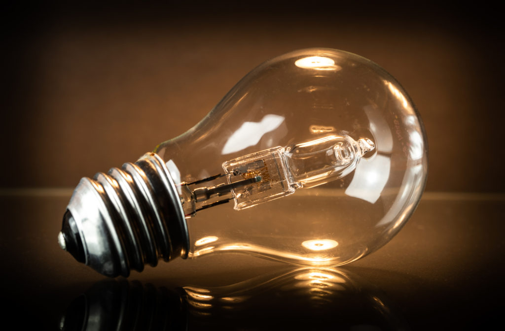 Light bulb sitting on dark background